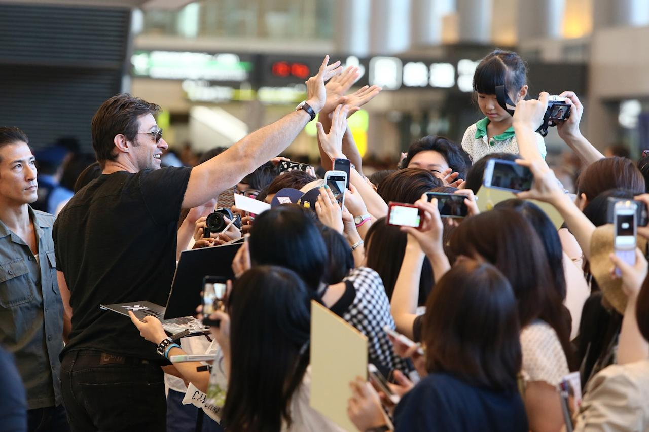 NARITA, JAPAN - AUGUST 27: Actor Hugh Jackman is seen upon arrival at Narita International Airport on August 27, 2013 in Narita, Japan. (Photo by Ken Ishii/Getty Images)