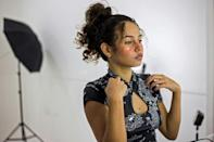 Valery Lopez prepares for a photoshoot to make content for her OnlyFans profile, in Caracas, on December 1, 2020 (AFP/Cristian HERNANDEZ)