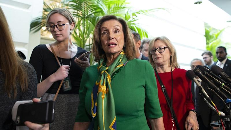 House Speaker Nancy Pelosi (c) is ready to send articles of impeachment to the US Senate