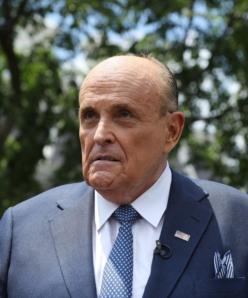 WASHINGTON, DC – JULY 01: President Donald Trump's lawyer and former New York City Mayor Rudy Giuliani talks to journalists outside the White House West Wing July 01, 2020 in Washington, DC. Giuliani did an on-camera interview with One America News Network's Chanel Rion before talking to other journalists about Vice President Joe Biden and the news that Russian intelligence may have paid Taliban operatives to kill U.S. troops in Afghanistan. (Photo by Chip Somodevilla/Getty Images)