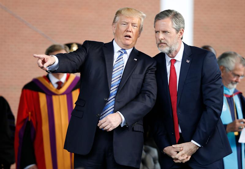 President Donald Trump speaks with Jerry Falwell Jr. during commencement ceremonies at Liberty University in Lynchburg, Virginia, on May 13, 2017. (Photo: Steve Helber/ASSOCIATED PRESS)