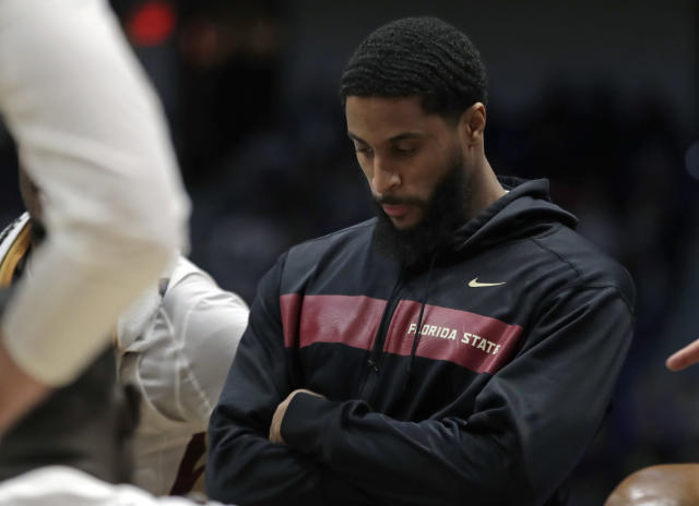 Florida State's Phil Cofer watches during a team huddle in the second half of a second round men's college basketball game against Murray State in the NCAA Tournament, Saturday, March 23, 2019, in Hartford, Conn. Florida State won 90-62. (AP Photo/Elise Amendola)