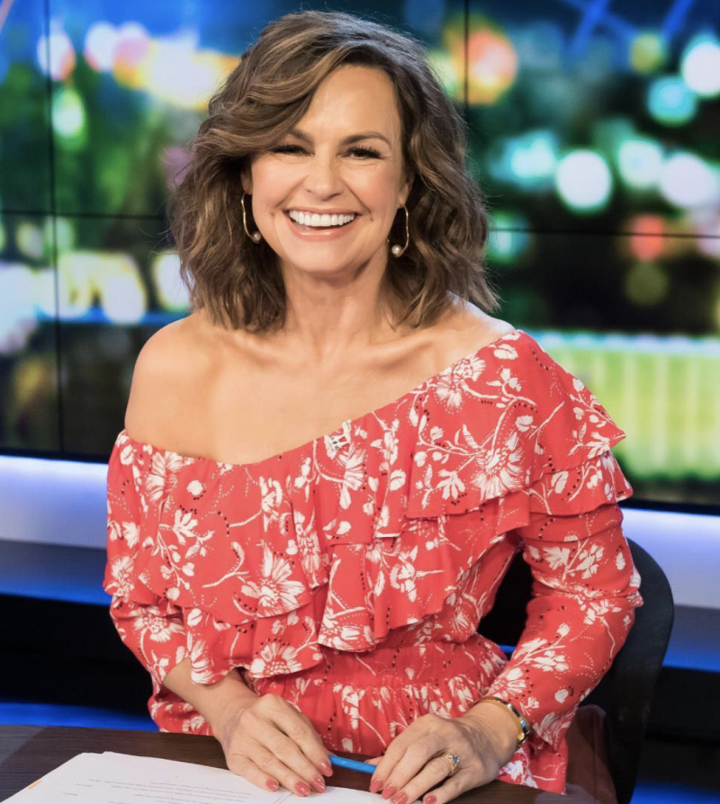 Lisa Wilkinson wearing a red dress on set of The Project