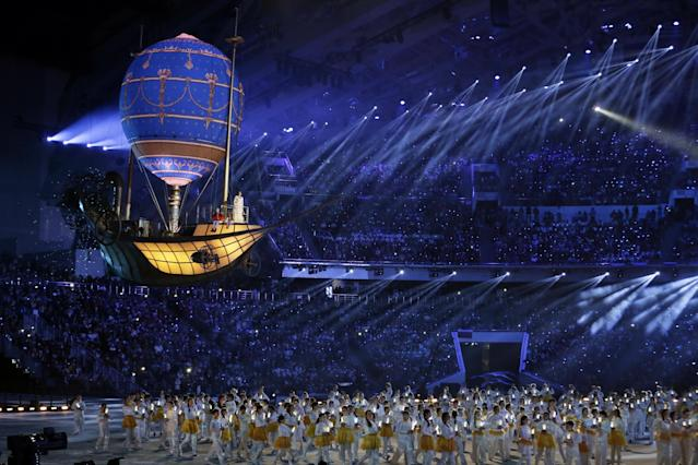 Performers clear the stage in the stadium during the closing ceremony of the 2014 Winter Olympics, Sunday, Feb. 23, 2014, in Sochi, Russia. (AP Photo/Charlie Riedel)
