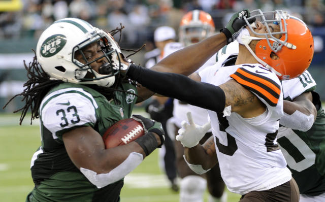 onNew York Jets running back Chris Ivory (33) stiff-arms Cleveland Browns' Joe Haden (23) during the second half of an NFL football game on Sunday, Dec. 22, 2013, in East Rutherford, N.J. (AP Photo/Bill Kostroun)