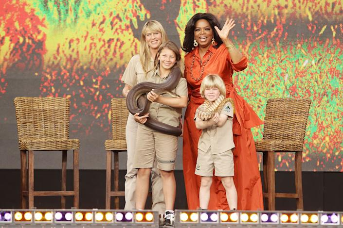 Oprah Winfrey poses with Terri Irwin, Bindi Irwin and Robert Irwin during the first taping of the 'Oprah Winfrey Show' at the Sydney Opera House on December 14, 2010 in Sydney, Australia. 12,000 audience members were selected from 350,000 applicants to participate in two tapings of 'The Oprah Winfrey Show' at the Sydney Opera House. Oprah descended on Australia last week with 302 super fans from the US, Canada and Jamaica to produce four shows for the 25th and final season of the program. the shows will air in the US and Australia in January 2011. (Photo by Brendon Thorne/Getty Images)