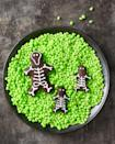 """<p>An eerie take on gingerbread men, this skeleton family decorated with <a href=""""https://www.goodhousekeeping.com/food-recipes/a28565256/royal-icing-recipe/"""" rel=""""nofollow noopener"""" target=""""_blank"""" data-ylk=""""slk:Royal Icing"""" class=""""link rapid-noclick-resp"""">Royal Icing</a> is the perfect addition to any Halloween party. </p><p><em><a href=""""https://www.goodhousekeeping.com/food-recipes/party-ideas/a28592622/chocolate-skeleton-cookies-recipe/"""" rel=""""nofollow noopener"""" target=""""_blank"""" data-ylk=""""slk:Get the recipe for Chocolate Skeleton Cookies »"""" class=""""link rapid-noclick-resp"""">Get the recipe for Chocolate Skeleton Cookies »</a></em></p>"""
