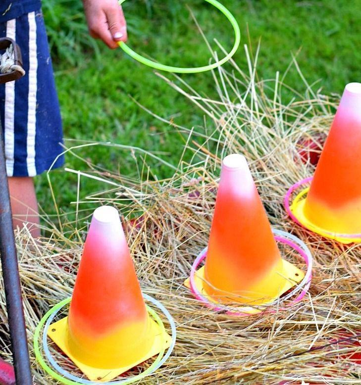 "<p>A little spray paint on some mini emergency cones and you have the fall version of horseshoes. </p><p><a href=""https://kidfriendlythingstodo.com/diy-candy-corn-ring-toss-glow-necklaces-fun-fall-halloween-thanksgiving-game/"" rel=""nofollow noopener"" target=""_blank"" data-ylk=""slk:Get the tutorial at Kid Friendly Things to Do »"" class=""link rapid-noclick-resp""><em>Get the tutorial at Kid Friendly Things to Do »</em></a></p>"
