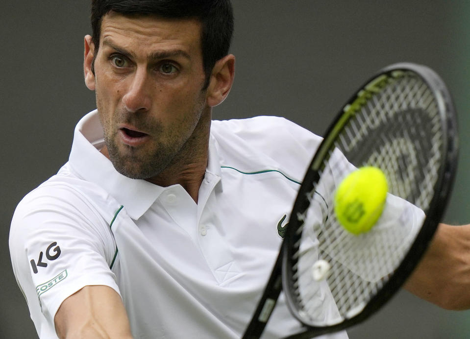 Serbia's Novak Djokovic plays a return to South Africa's Kevin Anderson during the men's singles second round match on day three of the Wimbledon Tennis Championships in London, Wednesday June 30, 2021. (AP Photo/Alastair Grant)