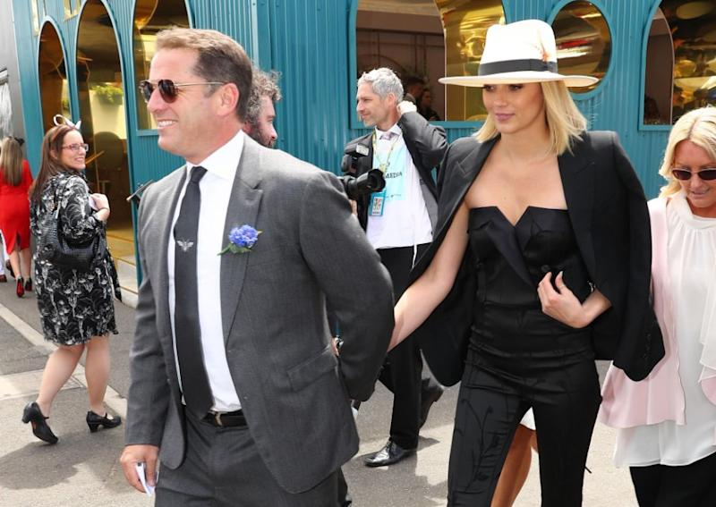 Karl and Jasmine's Melbourne Cup pictures sparked rumours about her 'pregnancy'. Source: Getty