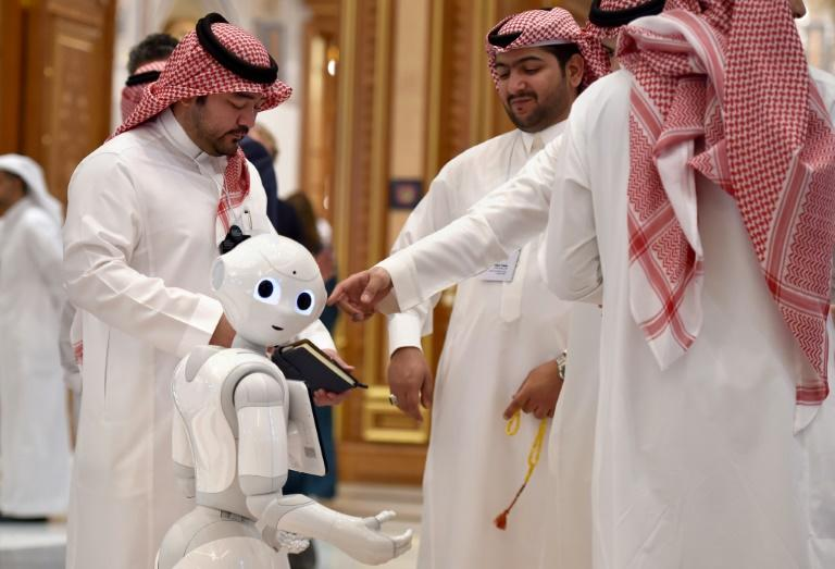 A robot stands in the crowd during the Future Investment Initiative forum at the King Abdulaziz Conference Centre in Riyadh, Saudi Arabia (AFP Photo/Fayez Nureldine)