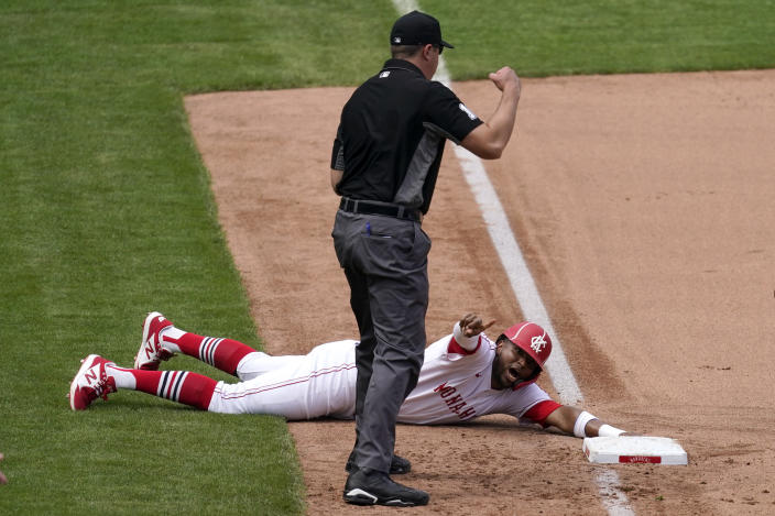 Kansas City Royals' Kelvin Gutierrez appeals to third base umpire Lance Barrett after being tagged out trying to advance to third on a sacrifice double play hit into by Hanser Alberto during the seventh inning of a baseball game against the Detroit Tigers Sunday, May 23, 2021, in Kansas City, Mo. Andrew Benintendi scored on the play. (AP Photo/Charlie Riedel)