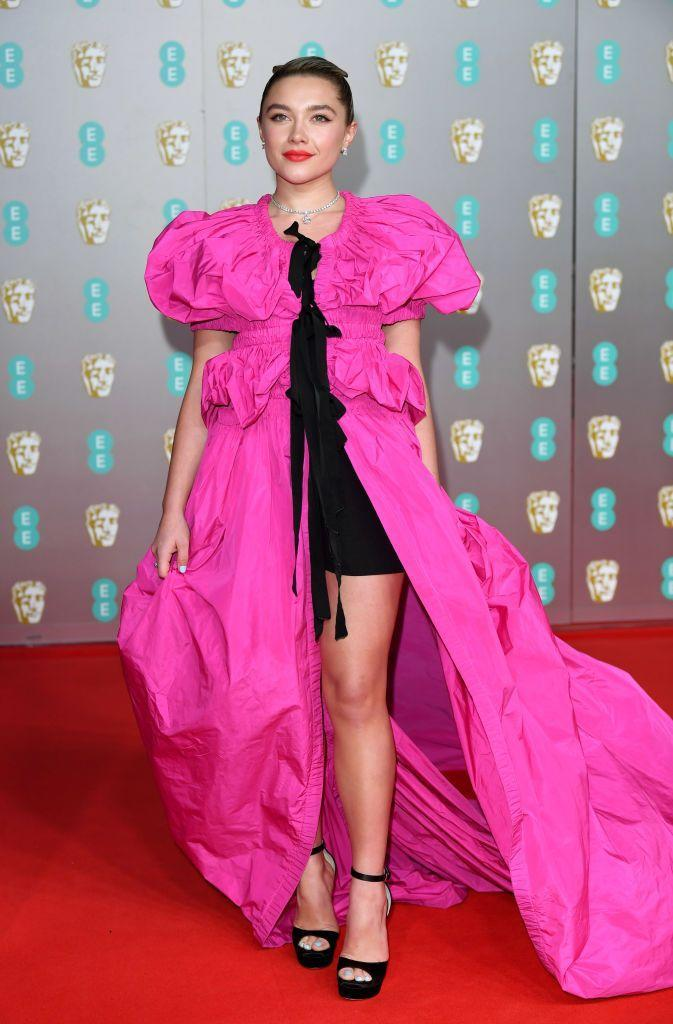 <p>The Midsommar star paired fuchsia with black to wear to the EE British Academy Film Awards 2020, February 2020. </p>