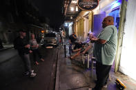 Patrons resume their socializing at Cuban Cigar Bar in the French Quarter in New Orleans, after power was restored Wednesday, Oct. 28, 2020. Hurricane Zeta passed through today leaving much of the city and metro area without power. (AP Photo/Gerald Herbert)