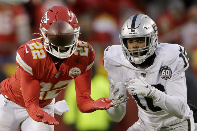 Kansas City Chiefs safety Juan Thornhill (22) intercepts a pass intended for Oakland Raiders wide receiver Keelan Doss (18) and returns it for a touchdown during the first half of an NFL football game in Kansas City, Mo., Sunday, Dec. 1, 2019. (AP Photo/Charlie Riedel)
