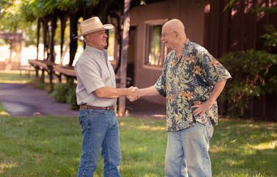 Founder of Steele Wines, Jed Steele, (right), congratulates new owner, Clay Shannon (left), on the promising future of expanded wine production in Lake County, CA.