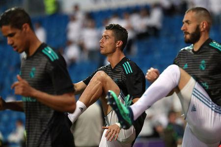 FILE PHOTO: Soccer Football - La Liga Santander - Real Madrid vs Athletic Bilbao - Santiago Bernabeu, Madrid, Spain - April 18, 2018 Real Madrid's Cristiano Ronaldo and Karim Benzema during the warm up before the match REUTERS/Susana Vera