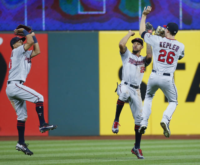 Minnesota Twins' Eddie Rosario, left, Byron Buxton, center, and Max Kepler celebrate a victory over the Cleveland Indians. (AP)