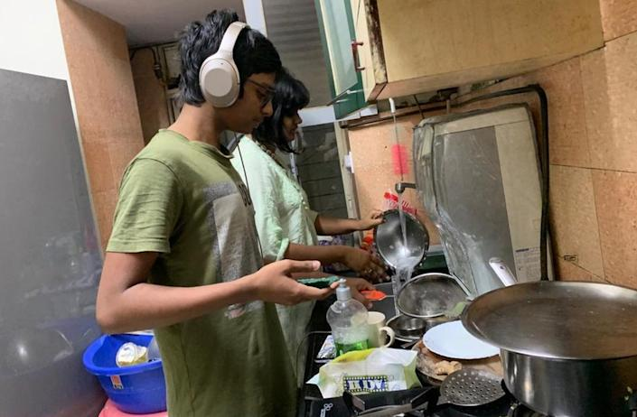 Subarna Ghosh's son and daughter doing the dishes at their home