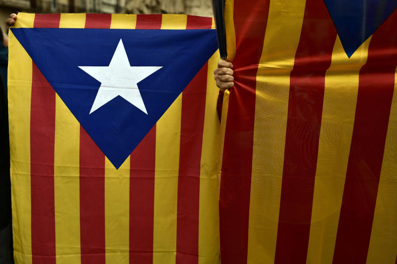 """Pro independence supporters holds the """"estelada"""" or pro independence flags during a rally in support for the secession of the Catalonia region from Spain, in Vitoria, northern Spain, Saturday, Sept. 9, 2017. Spanish Prime Minister Mariano Rajoy's office says members of his cabinet are meeting Thursday to react to plans by Catalan leaders who have scheduled a vote on the region's secession from Spain. (Alvaro Barrientos)"""