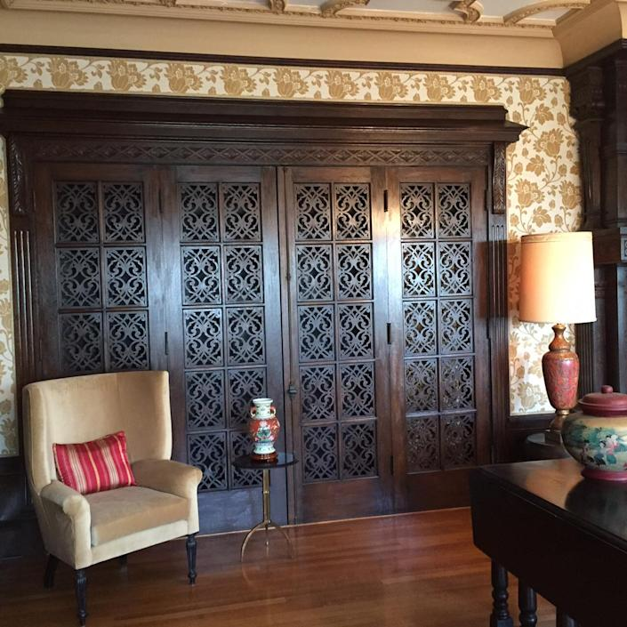 <p>This hand-carved screen in the music room hides organ pipes. The organ is on the other side of the room.</p>