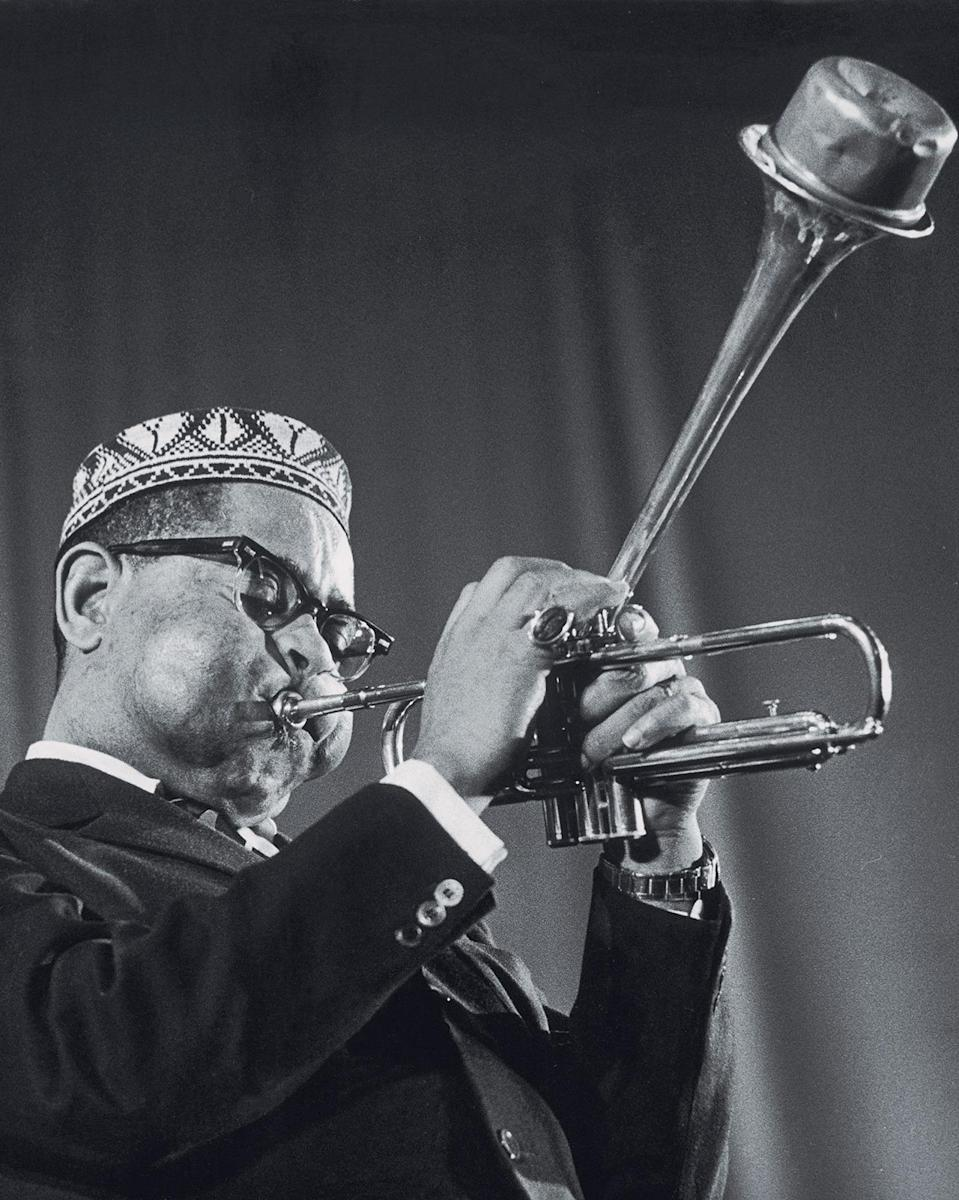 """<p>Trumpeter Dizzy Gillespie is considered an architect of modern jazz, along with the late Charlie Parker. Gillespie often played with friends in a quintet ensemble, where he was the show-stopper. He also had an incredible sense of humor, even in his playing — he took improvisational risks, as seen <a href=""""https://www.youtube.com/watch?v=2uLpjp7xkyI"""" rel=""""nofollow noopener"""" target=""""_blank"""" data-ylk=""""slk:here in his 1966 performance on """"Jazz 625."""""""" class=""""link rapid-noclick-resp"""">here in his 1966 performance on """"Jazz 625.""""</a> He wore stylish, thick-framed glasses and here, an ornate kufi in tribute to his African heritage. <i>(Photo: Getty Images)</i></p>"""