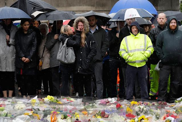 <p>People participate in a moment of silence to remember attack victims in the London Bridge area of London on Tuesday, June 6, 2017. (Photo: Matt Dunham/AP) </p>