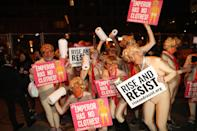 """<p>A group anti-Trump protesters from """"Rise and Resist"""" pose for a photo before the Village Halloween Parade in New York City on Oct. 31, 2017. (Photo: Gordon Donovan/Yahoo News) </p>"""