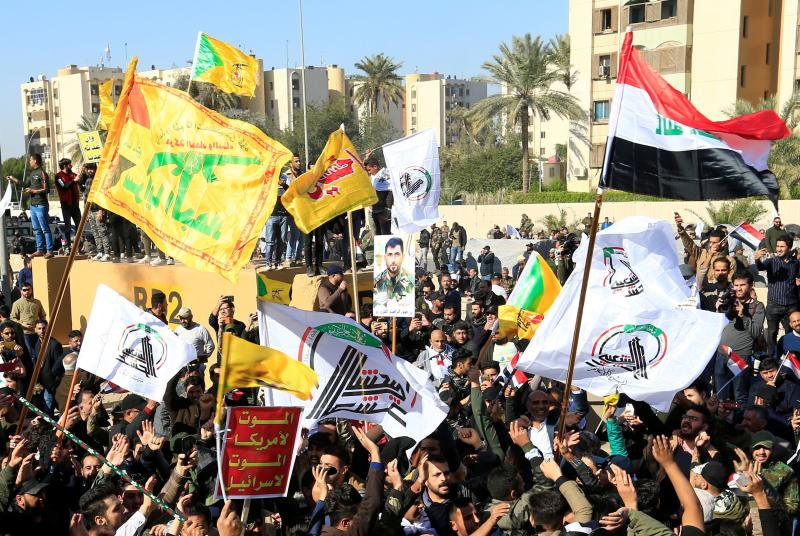 Protesters and militia fighters gather to condemn air strikes on bases belonging to Hashd al-Shaabi (paramilitary forces), outside the main gate of the U.S. Embassy in Baghdad, Iraq December 31, 2019. (Photo: Thaier al-Sudani/Reuters)