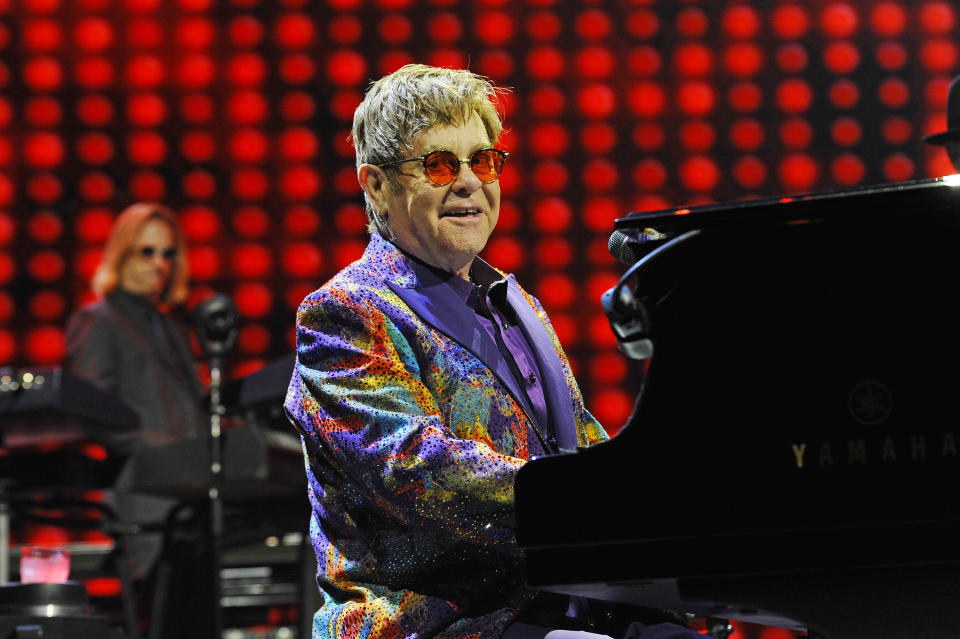 Photo by: x 2021 9/1/21 Lil Nas X to appear on Elton John's new album, 'The Lockdown Sessions'. STAR MAX File Photo: 6/7/17 Elton John performing at Genting Arena in Birmingham.
