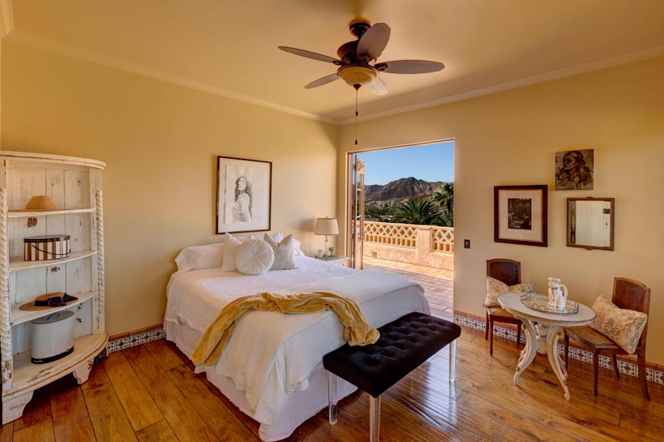 One of the bedrooms, which features a balcony.