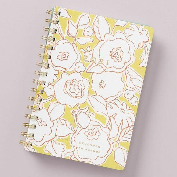 "Besides including weekly <em>and</em> monthly views at-a-glance pages, this planner also brings two sheets of stickers. We're sold! $26, Anthropologie. <a href=""https://www.anthropologie.com/shop/goldie-floral-2021-planner?color=074&type=STANDARD&size=One%20Size&quantity=1"" rel=""nofollow noopener"" target=""_blank"" data-ylk=""slk:Get it now!"" class=""link rapid-noclick-resp"">Get it now!</a>"
