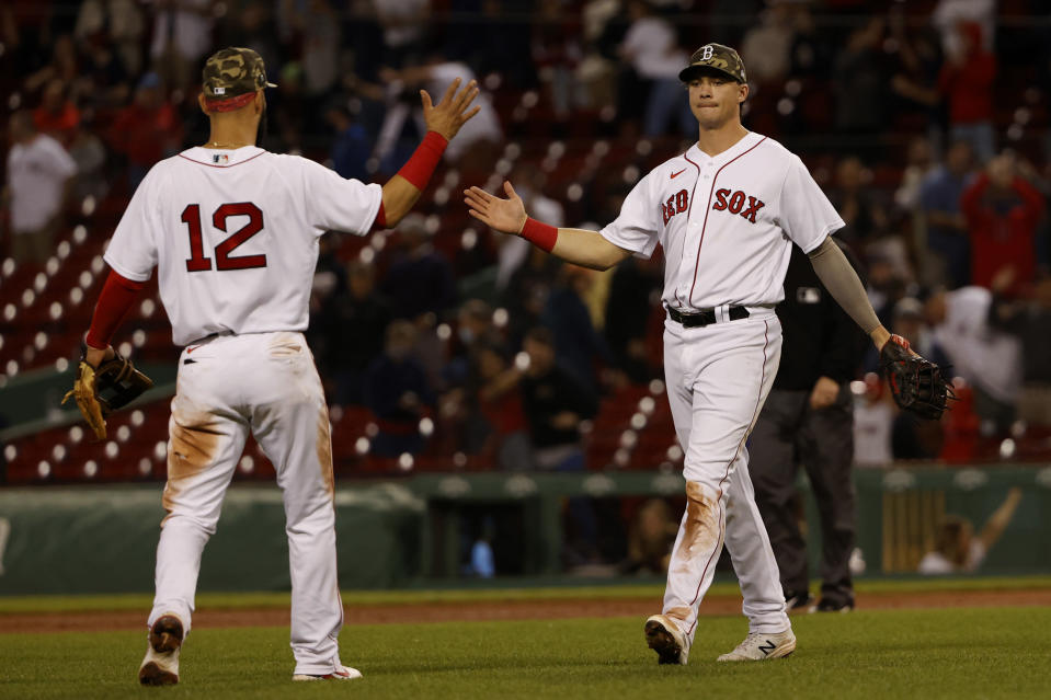 Boston Red Sox's Bobby Dalbec is congratulated by Marwin Gonzalez (12) after their win over the Los Angeles Angels in a baseball game Friday, May 14, 2021, at Fenway Park in Boston. (AP Photo/Winslow Townson)
