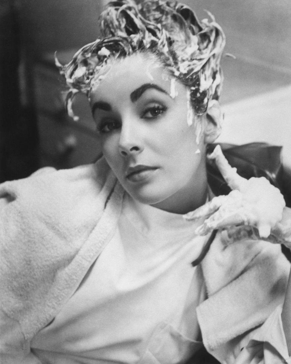 <p>Elizabeth shows off her silly side by posing for a goofy photo while getting her hair washed.</p>