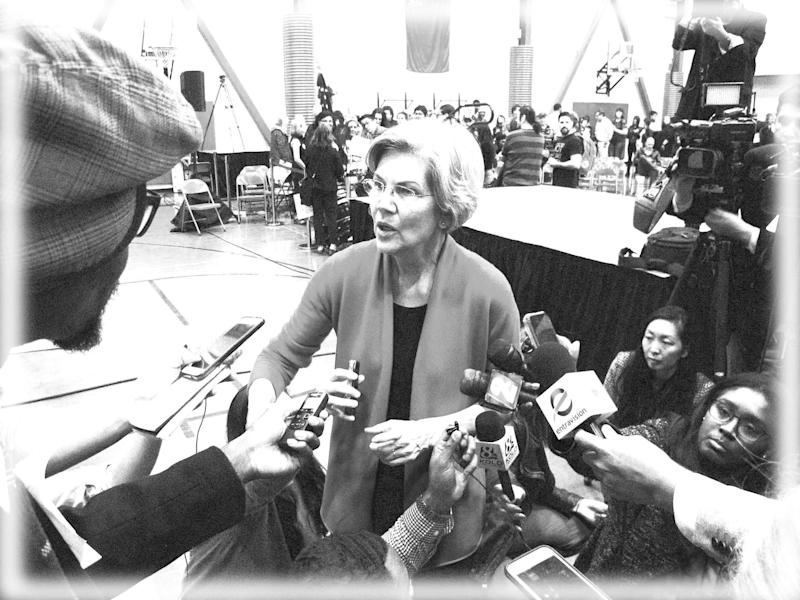 Warren meets the press in Reno, Nev., April 6, 2019. (Photo: Scott Sonner/AP; digitally enhanced by Yahoo News)