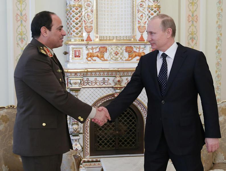 Russian President Vladimir Putin, right, shakes hands with Egypt's Military chief Field Marshal Abdel-Fattah el-Sissi in the Novo-Ogaryovo residence outside Moscow on Thursday, Feb. 13, 2014. Russian President Vladimir Putin on Thursday wished Egypt's military chief victory in the nation's presidential vote as Moscow sought to expand its military and other ties with a key U.S. ally in the Middle East. (AP Photo/RIA Novosti, Mikhail Metzel, Presidential Press Service)