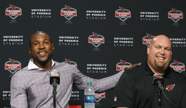 Arizona Cardinals' Patrick Peterson, left, thanks general manager Steve Keim as they announce an agreement on a five-year, $70 million contract with $48 million guaranteed money with the football team at a news conference on Wednesday, July 30, 2014, in Glendale, Ariz. The agreement keeps Peterson under contract with Arizona through 2020. (AP Photo/Ross D. Franklin)