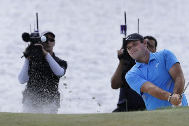 Patrick Reed hits out of a bunker on the fourth hole in the final round of the Northern Trust golf tournament at Liberty National Golf Course, Sunday, Aug. 11, 2019, in Jersey City, N.J. (AP Photo/Mark Lennihan)