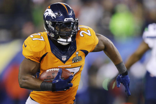 Denver Broncos' Knowshon Moreno takes the ball down field against the Seattle Seahawks during the first half of the NFL Super Bowl XLVIII football game Sunday, Feb. 2, 2014, in East Rutherford, N.J. (AP Photo/Julio Cortez)