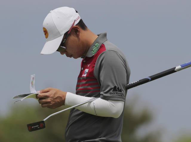Jazz Janewattananond, of Thailand, checks his notes before putting on the 12th green during the second round of the PGA Championship golf tournament, Friday, May 17, 2019, at Bethpage Black in Farmingdale, N.Y. (AP Photo/Charles Krupa)