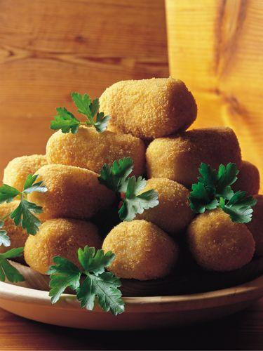 <p>Form cold mashed potatoes into little balls, dip in beaten egg, coat in bread crumbs, and sauté or deep-fry. You can also mix in crabmeat or salmon.</p>
