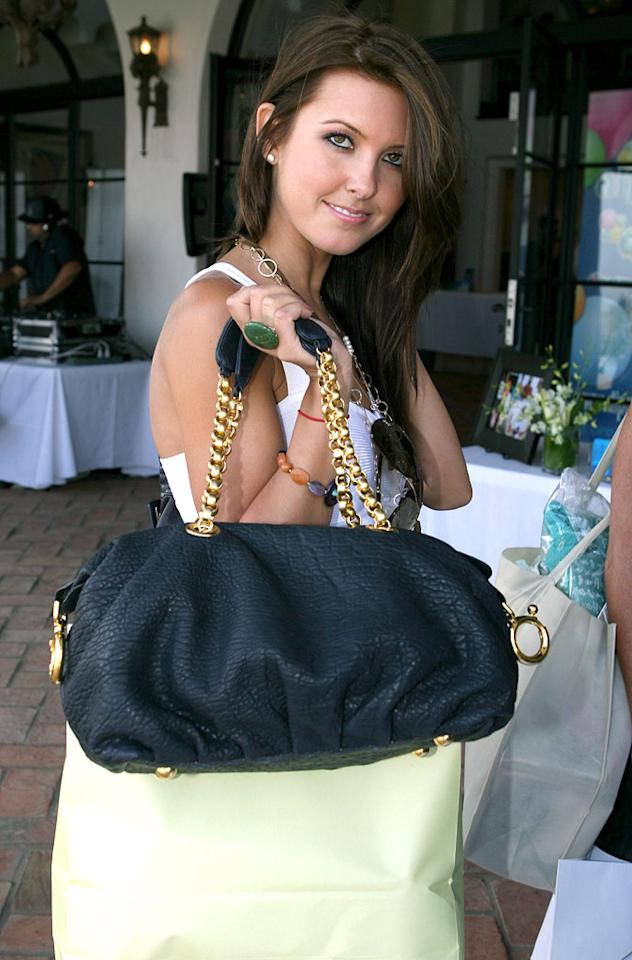 """Audrina Patridge loads up with goodies from the MTV Movie Awards Style Lounge. Alexandra Wyman/<a href=""""http://www.wireimage.com"""" target=""""new"""">WireImage.com</a> - May 31, 2007"""