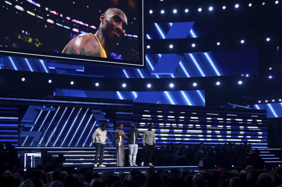 Nathan Morris, from left, Wanya Morris, Shawn Stockman, of Boyz II Men‎, and Alicia Keys, second left, sing a tribute in honor of the late Kobe Bryant, seen on screen, at the 62nd annual Grammy Awards on Sunday, Jan. 26, 2020, in Los Angeles. (Photo by Matt Sayles/Invision/AP)