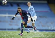 Manchester City's Phil Foden, right, challenges PSG's Neymar during the Champions League semifinal second leg soccer match between Manchester City and Paris Saint Germain at the Etihad stadium, in Manchester, Tuesday, May 4, 2021. (AP Photo/Dave Thompson)