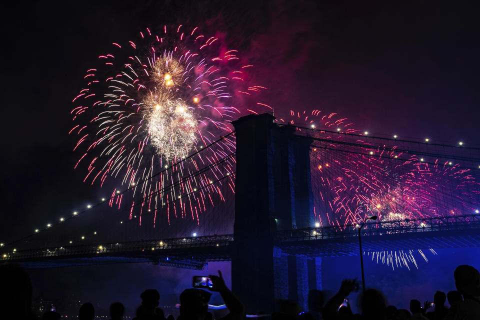 People on the east side of Manhattan watch a fireworks display, part of Independence Day festivities, July 4, 2019, in New York. (Photo: Jeenah Moon/AP)