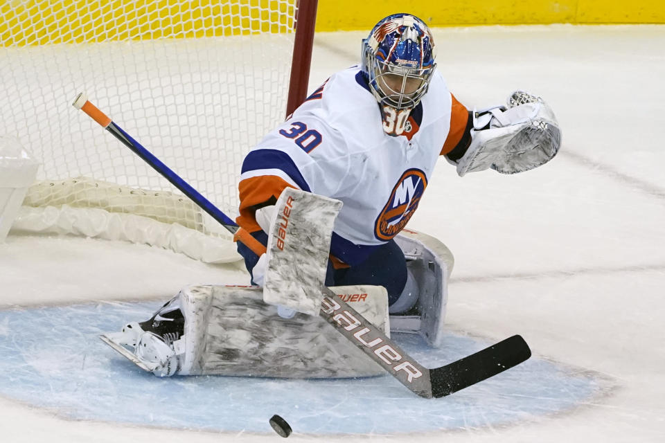 New York Islanders goaltender Ilya Sorokin (30) defends against a shot during the first period of an NHL hockey game against the New Jersey Devils, Sunday, Jan. 24, 2021, in Newark, N.J. (AP Photo/Kathy Willens)