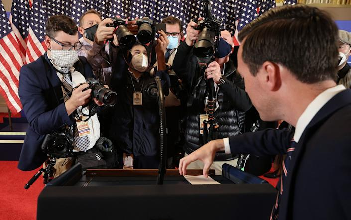 Deputy Press Secretary Judd Deere takes away notes form the podium where U.S. President Donald Trump delivered remarks on election night - Getty Images North America