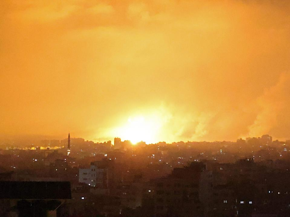An explosion lights the sky following an Israeli air strike on Beit Lahia in the northern Gaza Strip (MOHAMMED ABED/AFP via Getty Images)