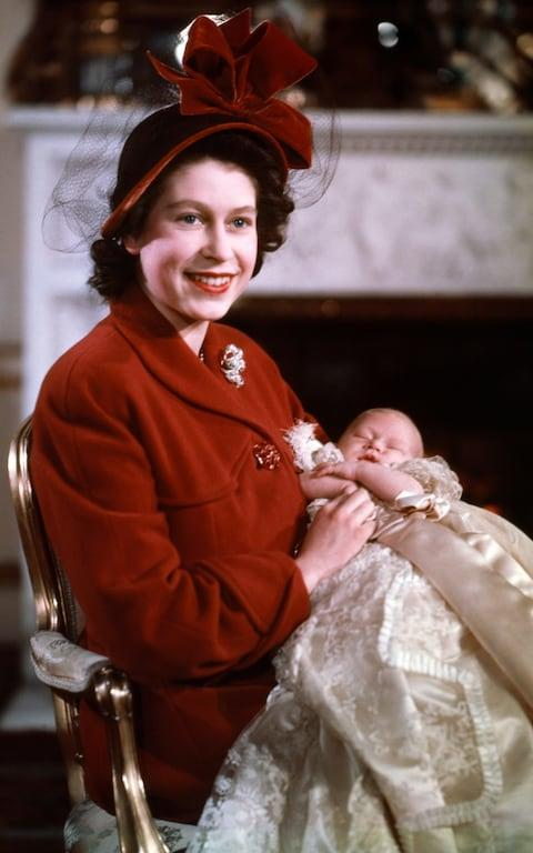 The Queen with her son and heir on the day of his christening in December 1948 - Credit: Camera Press/Baron