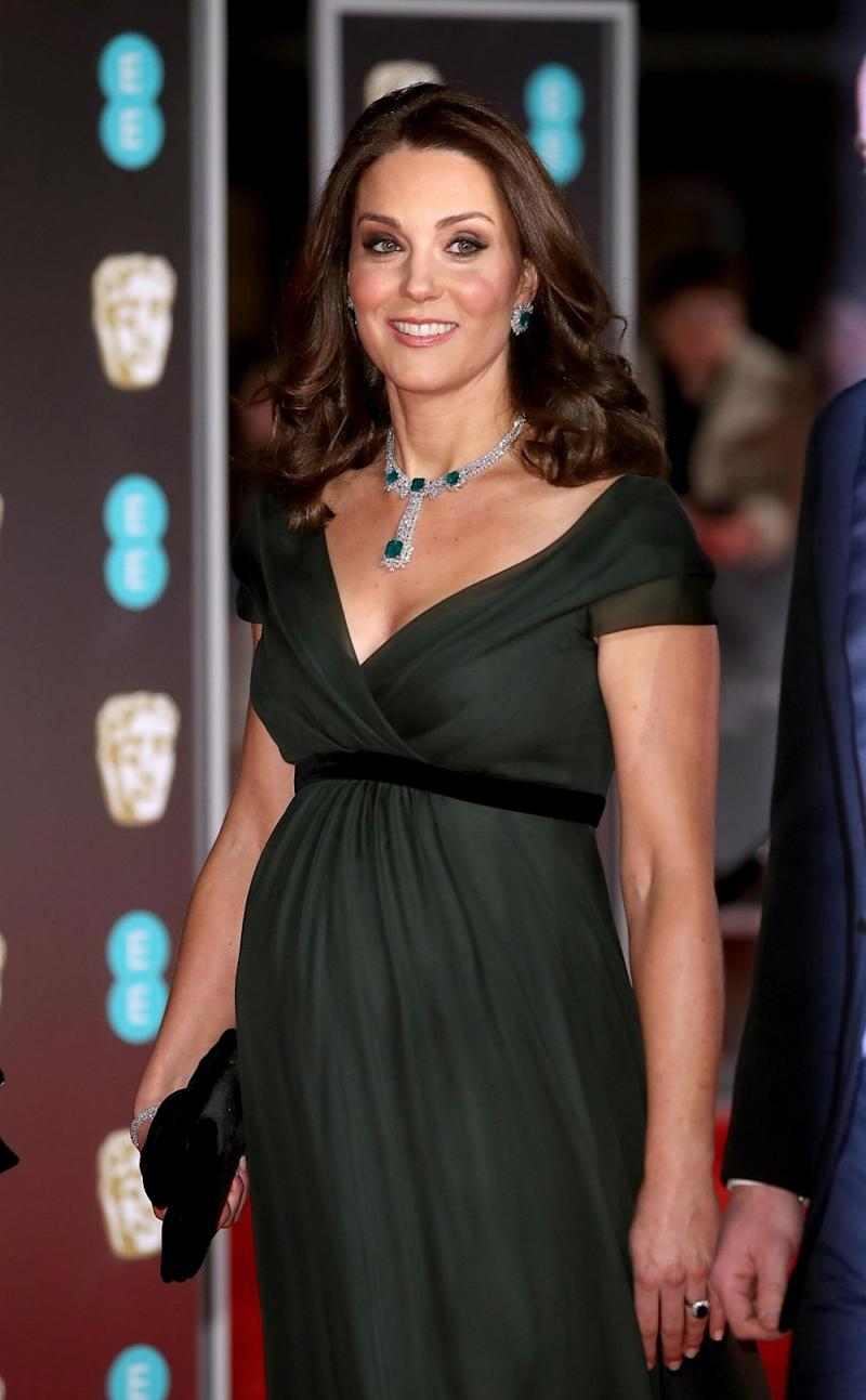 Despite the call to wear black, the Duchess was seen in a green gown. Photo: Getty